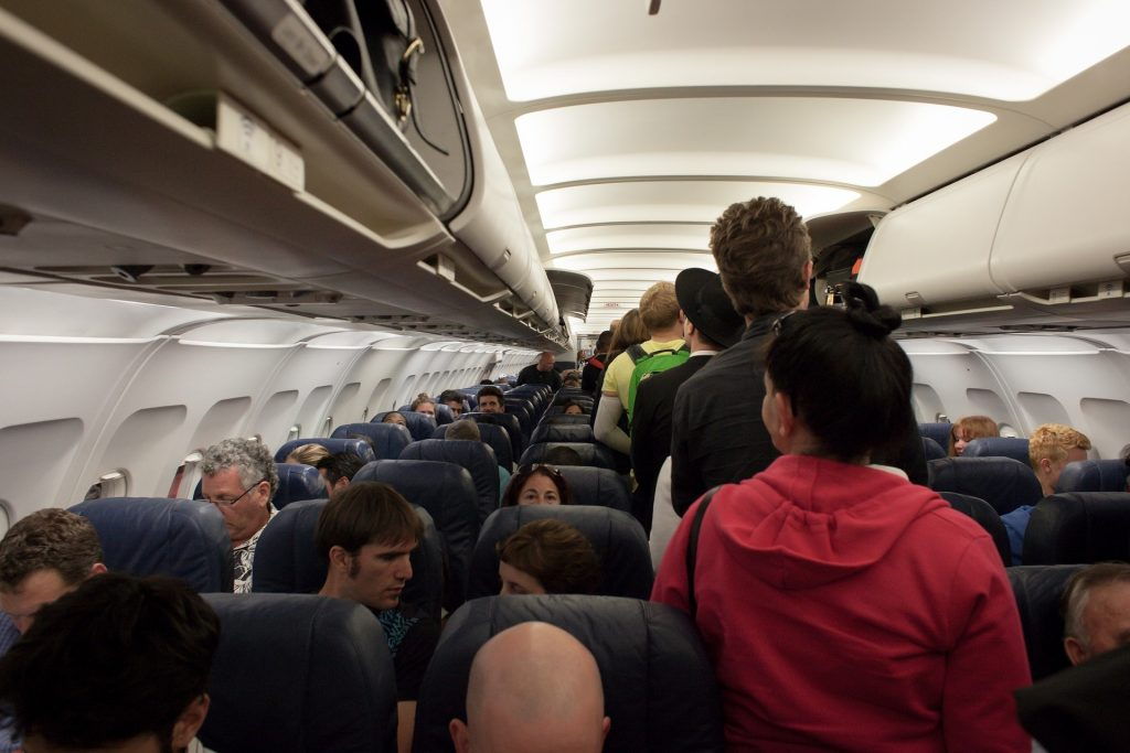 Queuing on airplane aisle with no social distancing